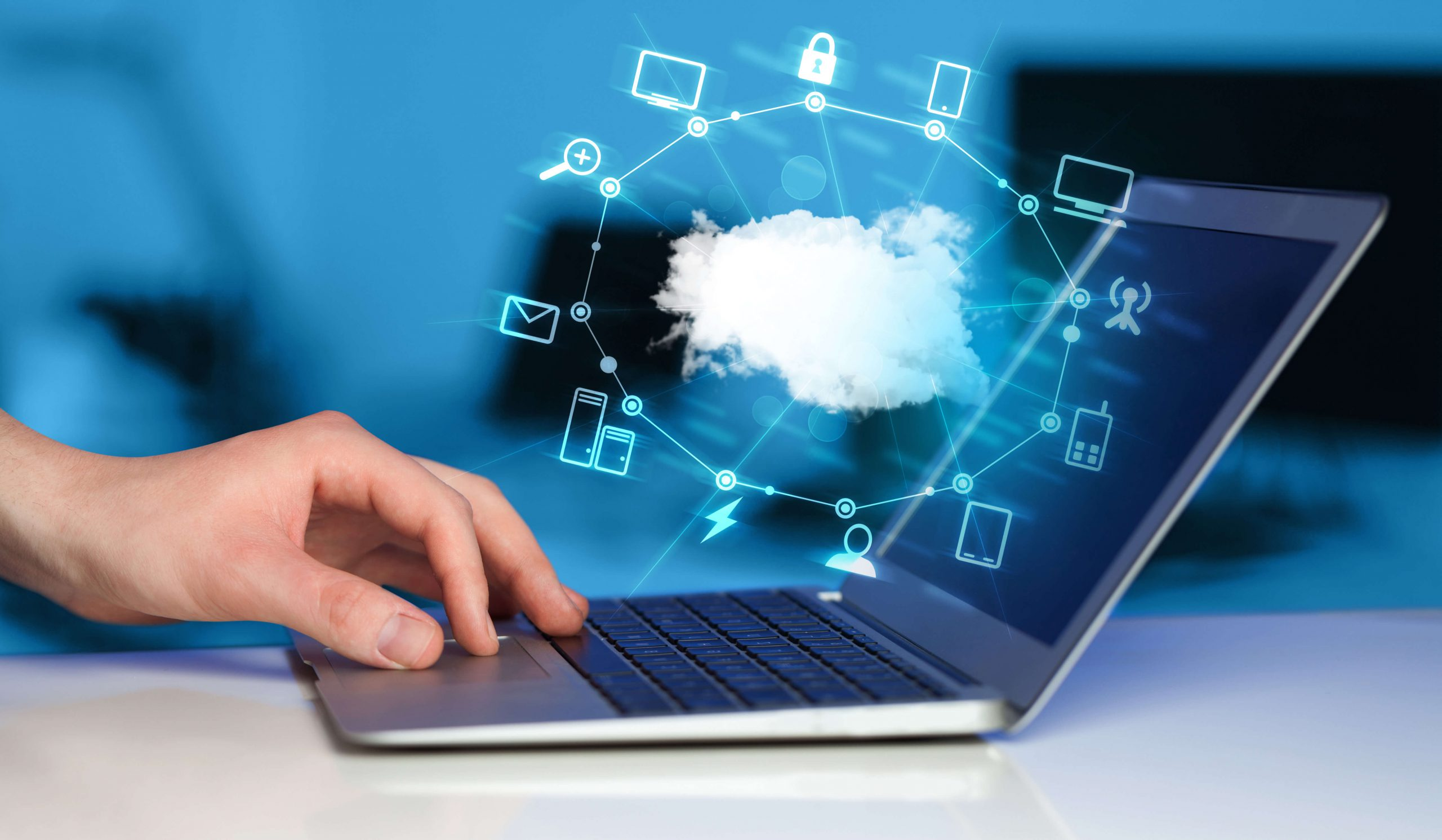 conceptual icons for connectivity surround a cloud hovering over a laptop